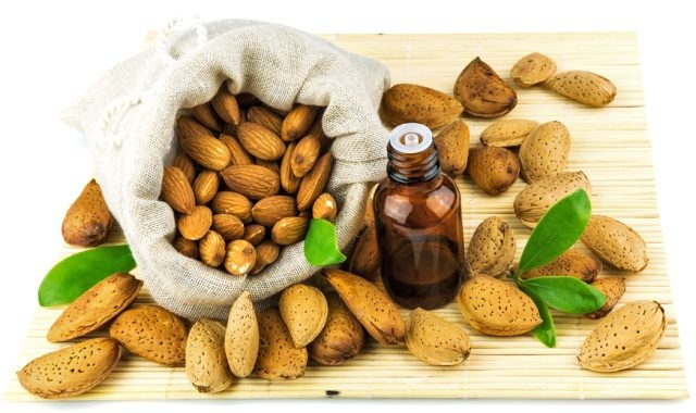 almonds-in-the-sack-and-almond-oil-on-mat-isolated-on-white-background-4